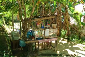 Tiny food stall selling coffee, noodlesoup and sweets on a side road in Sorong