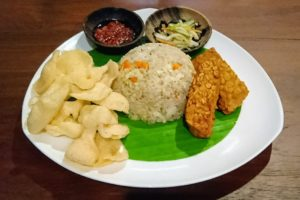 Plate of fried rice with tempe, kerupuk and sambal