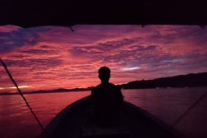 View of the sunset from a speedboat in Raja Ampat