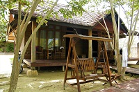 Wooden bungalow in Sorong area with wooden swing in front