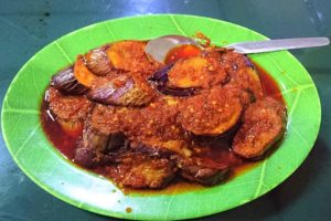 A plate of fried eggplant with sambal sauce